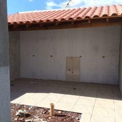 Vende casa 02 quartos, garagem, e edicula